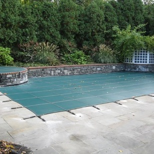 Photo of pool that has been cleaned, closed and covered for the winter