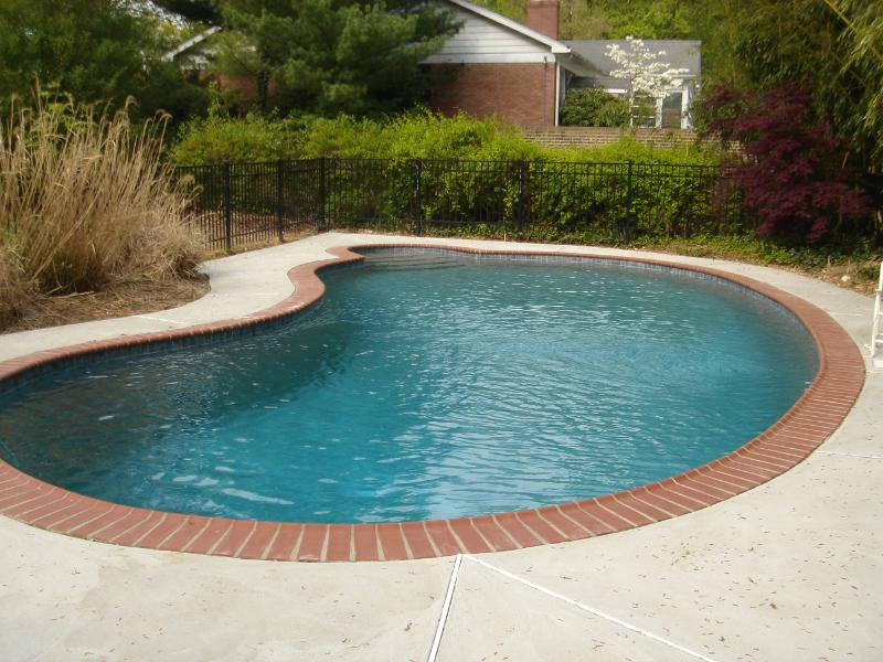 Residential swimming pool services and maintenance : photo of pool with Pebble Tec® pool finish