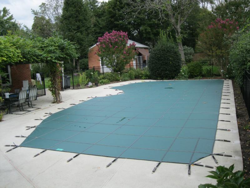 An in-ground swimming pool located in Arden, Delaware prepped for winter months. A custom Loop-Loc Ultra Loc II Solid pool cover installed by Colony Pool Service of Delaware Inc., an authorized Loop-Loc dealer and supplier of all residential pool equipment.